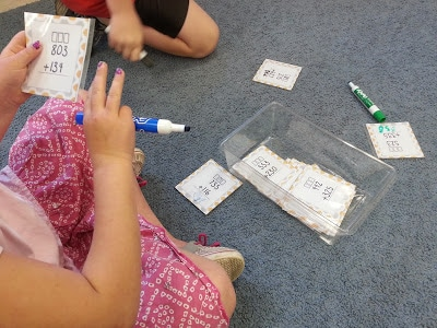 Student counting on fingers