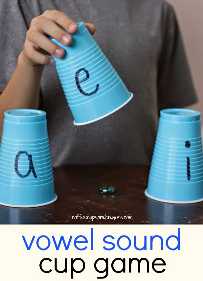 Vowel sound cup game for teaching vowels in the classroom.