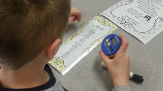 Primary student using stopwatch timer.